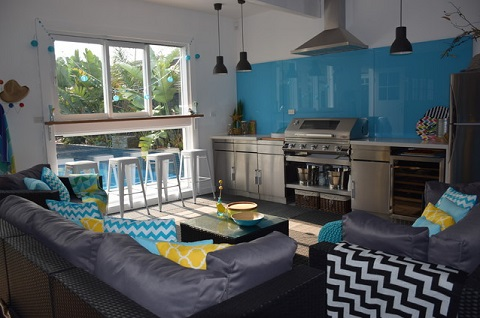A garage conversion that opens up on your back yard is a great way to enjoy year-round entertaining even in harsher climates (by Colour Pop Interior Design, Janine Monks )