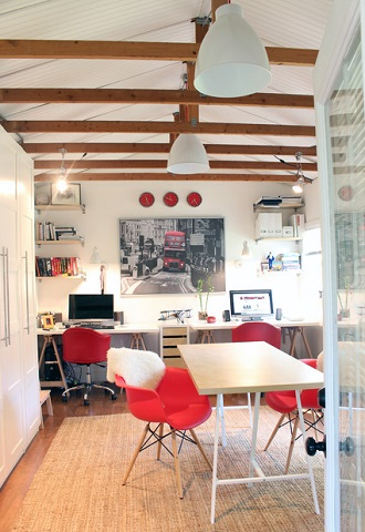 A home office, gym, or studio built in a garage offers not only a bit of privacy, but can even help lower utility costs for those who work from home (by Suzanne Dingley Interiors)