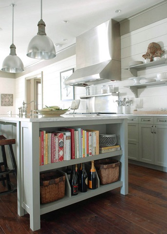 Adding a bookshelf to your kitchen island is a great way to keep your cookbooks close at hand, and put them nicely on display (by Dresser Homes, David C. Fowler and Associates)