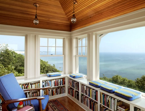 Placing knee or waist high bookshelves underneath a window not only preserves your view but creates a comfortable spot to sit and enjoy it (by Albert, Righter & Tittmann Architects, Inc., photo by Robert Benson)