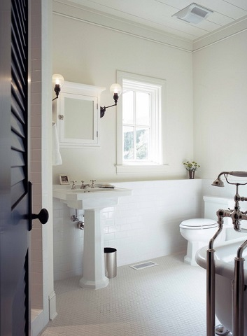 A solid white on white bathroom can feel a bit stark, especially with little natural light, so consider adding visual interest with multiple textures or colored grout, or warmth with pastel paint or even wood flooring or beams (by Group 3 Designs)