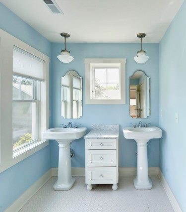Dual pedestal sinks can be a major space saver in a small master bathroom, and they provide a nice sense of symmetry, too (by Echelon Custom Homes)
