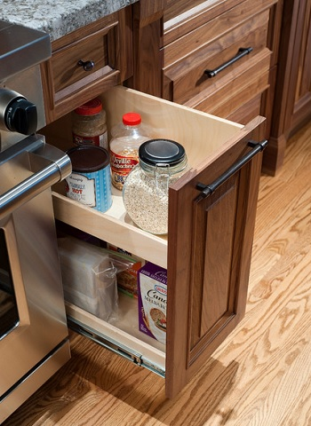 Pull out cabinets allow instant, easy access to items and help minimize clutter (by Old World Kitchens & Custom Cabinets, photo by Bob Young)