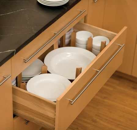 Segmented drawers can store a full set of dinnerware in less space than a traditional cabinet, and keep individual pieces better sorted (by Dura Supreme Cabinetry)
