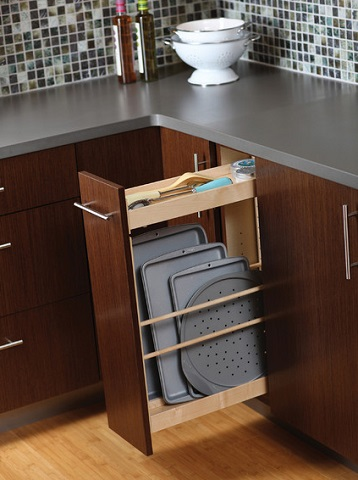 Slim pull out cabinets can fit in spaces that traditional cabinets can't, and are much more efficient for odd shaped items (by Dura Supreme Cabinetry)