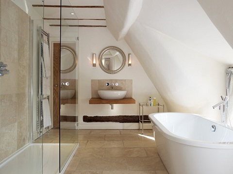 Attics aren't the ideal space for building just about anything, but with the right pre-planning, they can be the perfect spot to add a full bath (by Mary Barber Fray Interior Design)