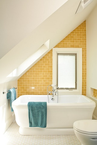Dividing an attic bath along the middle reduces the space you have to walk at full height, but provides a usable, vertical surface and keeps the bathroom from feeling over-large (by Renewal Design-Build)