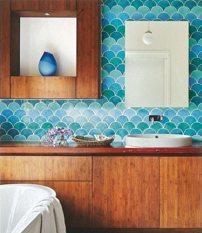 Fish scale patterned tile comes in a wide variety of colors, from simple and subtle to something as bold and bright as this blue-green array (by Camilla Molders, photo by Armelle Habib)