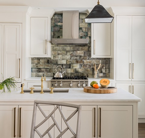 Rectangular stone tile is pretty far removed from traditional subway tilee, but it can make for an eye-catching accent (by Lovejoy Designs, photo by Michael J. Lee)