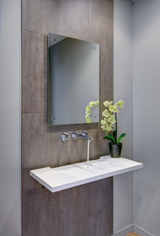Minimalist, unusual, and sculptural wall mounted sinks make for a gorgeous statement, though some of the more complex or seamless designs require more complicated installation (by Rochman Design-Build Inc., photo by Steve Kuzma)