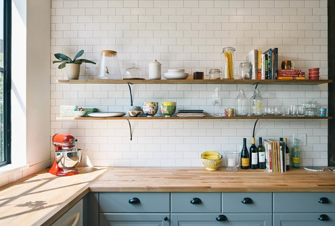 Whether for functionality or for show, wood countertops add a nice, relaxed, casual feel to a kitchen (by PAVONETTI Office of Design, photo by Amanda Kirkpatrick)