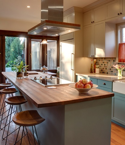 With a little DIY-ability, wood countertops can be a great way to keep expenses low on a major kitchen remodel (by Synthesis Inc.)