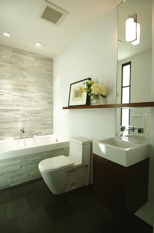 Wall mounted bathroom vanities are a staple of small bathroom design, but the custom mirror lends height, depth, and elegance to the space (by Mark Brand Architecture)
