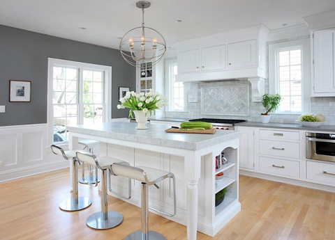 Mixing modern and traditional materials gives this gray and white kitchen a look that's both timeless and trendy (by Normandy Remodeling)