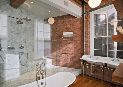 Brick is a classic industrial material, but if you want to keep it looking clean and decoroative rather than run down, you need to incorporate a few more finished materials (by Jane Kim Design)