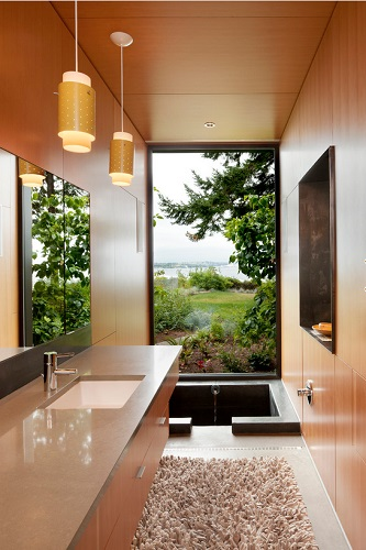 Japanese style soaking tubs are some of the most stylish space savers, and can give an odd shaped bathroom a really elegant, sophisticated feel (design by Coates Design Architects Seattle)