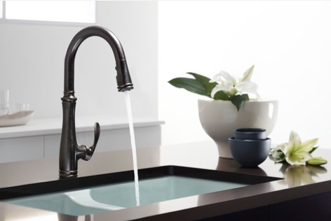 One-handled sinks can also fit an elegant, vintage kitchen. By Eclectic Kitchen.