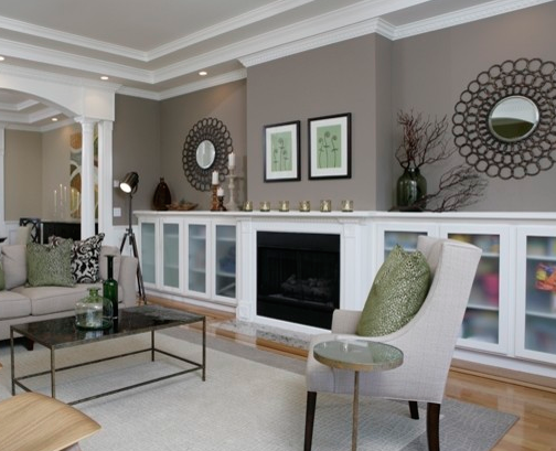 Symmetrical accents and textures work add balance to a room. (By Amoroso Design)
