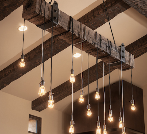 Hanging lights are a great way to utilize reclaimed wood. (By Tate Studio Architects. Photo by Mark Boisclair Photography.)