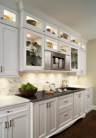 Small spotlights - whether they're aimed at your dishes or the architectural features of your kitchen - can bring out the subtly stylish details of your space (by Millennium Cabinetry, photo by Beth Singer)