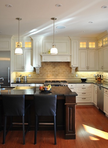 Under cabinet lights aren't just functional, they also do a great job bringing out the detail in your backsplash and adding depth to your countertops (by 2Go Custom Kitchens)
