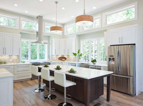 Replacing a single bright lighting fixture with lots of smaller ones spaced evenly throughout the room will give you better over-all illumination and help combat the shadowy corners of your kitchen (by Turan Designs)