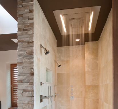 An overhead shower head is a unique and creative touch. (By ART Design Build, photo by Tsantes Photography)