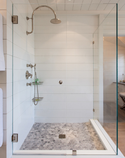 Glass-enclosed showers are sleek, stylish, and clean. (By Jonathan Raith Inc., photo by Nantucket Architectural Photography)