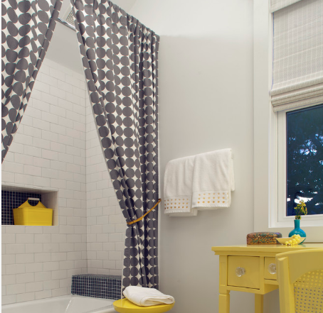 Spice up a combined shower/bath with a trendy shower curtain. (By Rethink Design Studio)