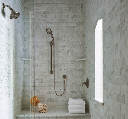 A detachable shower head is a simple and convenient improvement. (Martha O'Hara Interiors)