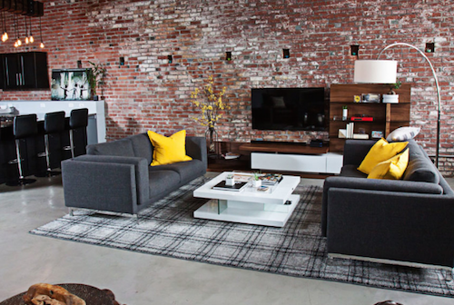 Exposed brick, steel, and glass all say contemporary. (By Shaping Your Space)