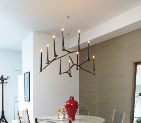 More contemporary-inspired chandeliers lower the formality of a setting. (By Croma Design Inc)