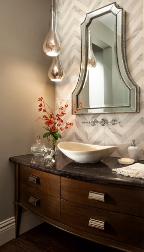 Choosing a few pieces that evoke very traditional elements is a great way to pull off a very classic style in a very small powder room (by Robeson Design)