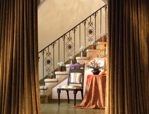 Open plan rooms can be accorded some privacy with curtains. (Tommy Chambers Interiors, inc.)