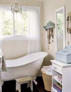 A Slipper Tub And Chandelier Add Elegance To An Otherwise Simple Bath