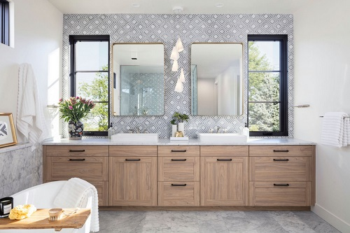 An image of a bathroom with a full-height backsplash above the vanity, featuring a graphic design of concentric diamonds