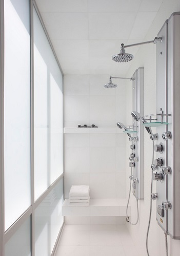 Shower panels are an affordable, easy-to-install, and water-saving alternative to a custom shower, but they'll never provide quite the same immersive shower experience (by Group 41 Architects)