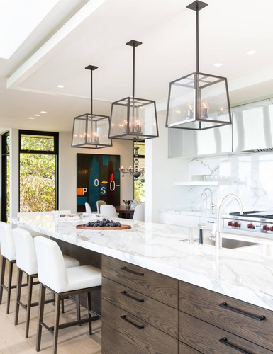 An image of a kitchen island topped by three lantern-style pendant lights