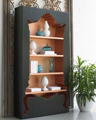 An image of a solid black rectangle with the shape of an antique armoire cut into the surface, with filled shelves mounted inside
