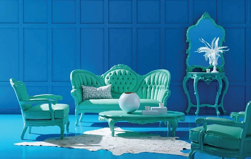 An image of a living room with blue walls and floors. The living room furniture is baroque-styled, but a solid robin's egg blue