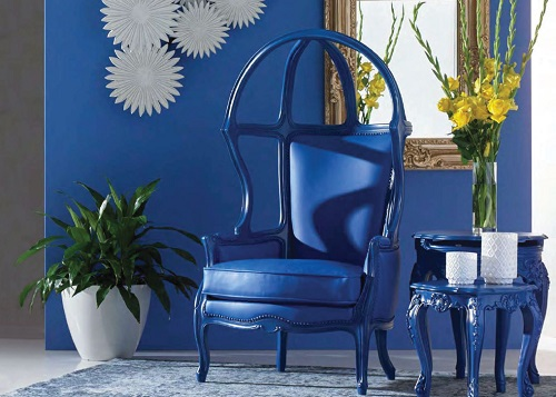 An image of an antique-styled dome chair done in solid blue plastic and vinyl