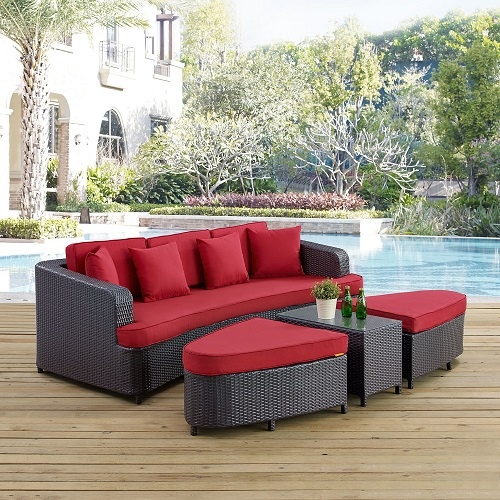 A four-piece outdoor bed with a footrest that converts into two ottomans and a small table. The image links to a product page selling this item.