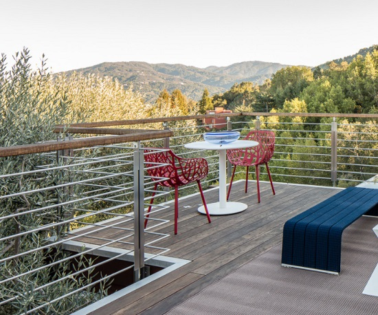 Wire frame furniture that mimics or contrasts your patio railing creates a transparent., three-dimensional look that can turn an eyesore into something interesting (by Applegate Tran Interiors)