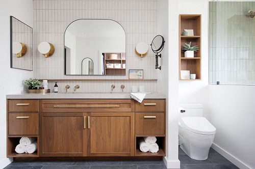 An imnage of a bathroom. The toilet is located at the far end, and separated from the vanity area by a narrow, full-height wall