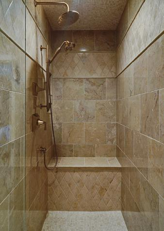 Contrasting Large And Small Squares And Harlequin Diamonds Helps Keep This Solid Travertine Shower Looking Fresh (by The Kingston Group)