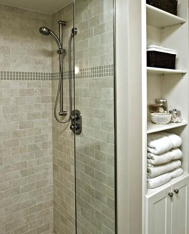 This Basic Mosaic Border Helps Give This Simple Shower Added Character (by Avalon Interiors)