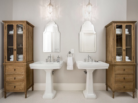Paired pedestal sinks have a gordeous sense of symmetry that gives them a great, classic look (by Fox Group Construction, photo by Scott Davis)