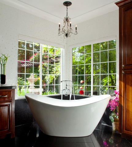 Garden tubs not only make the most of your bathroom's natural light, but make for a more luxurious bathing experience (by Granite Transformations Atlanta)
