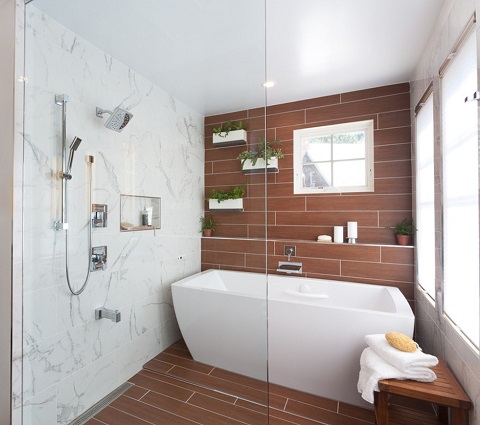 Putting a bathtub inside your shower stall might seem like overkill, but it's actually a great way to control the moisture levels in your bathroom (by Grossmueller's Design Consultants)