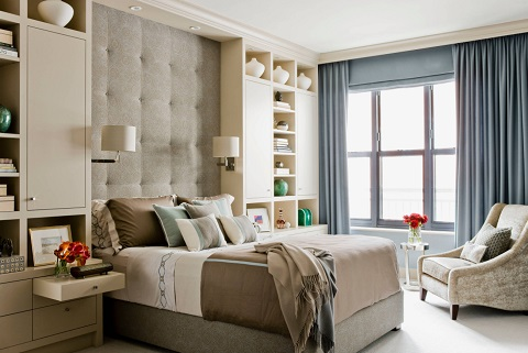 Custom built-in headboards make it possible to get exactly the kind of storage right where you want it, and make it easy to install new lighting fixtures without rewiring your walls (by Elms Interior Design)